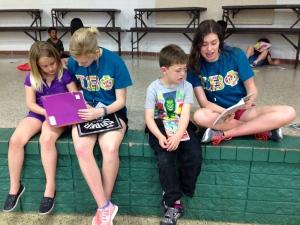 Arkansas Alpha sisters volunteer to read to children through the University's Volunteer Action Center.